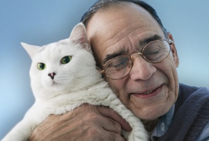 older man with cat